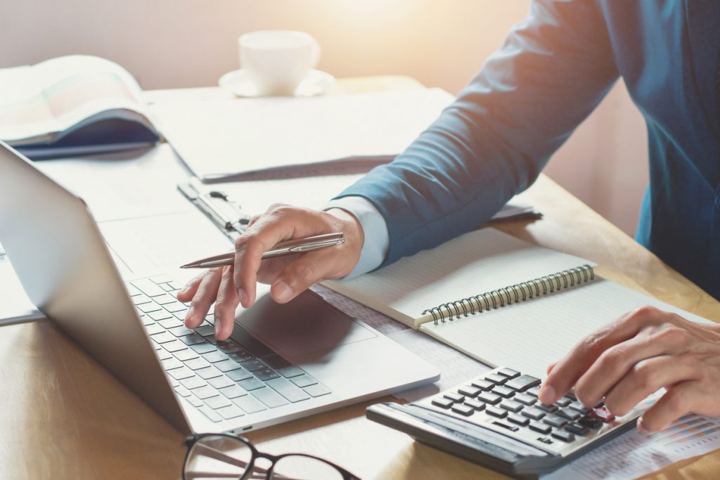 budget planning using laptop and calculator