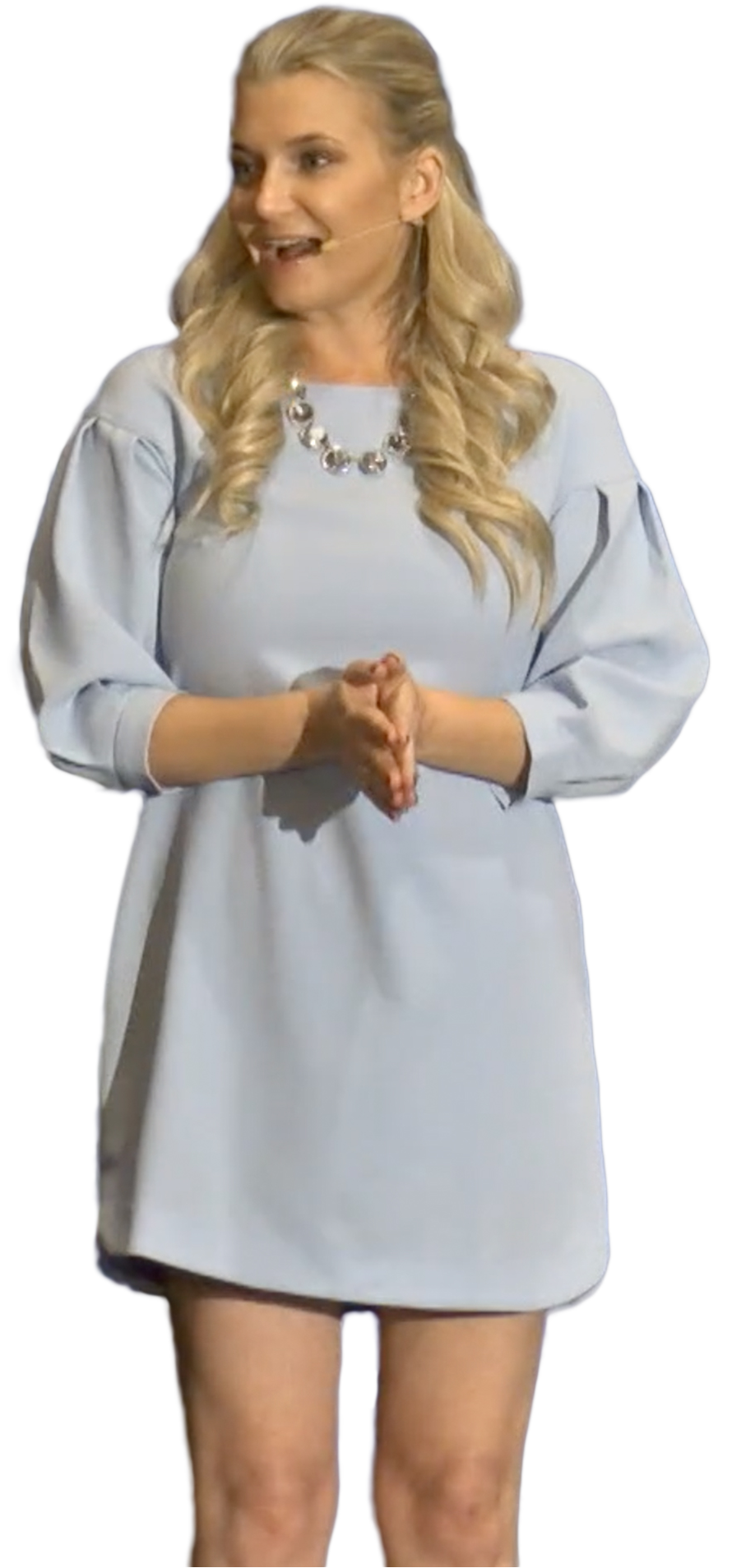 a woman in a blue dress with blonde hair speaking about Med Spa Marketing
